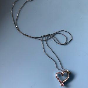 Jewelry - Heart shaped silver necklace.